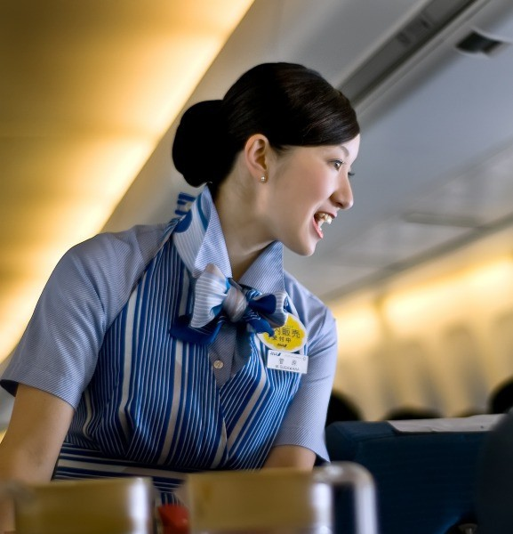 A Flight Attendant is seen looking after a passenger.